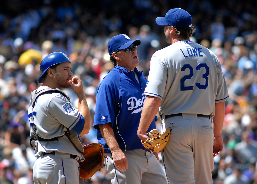 04 May 2008: Los Angeles Dodgers pitching coach Rick Honeycutt and catcher Russell Martin visit starting pitcher Derek Lowe during a game against the Colorado Rockies on May 4, 2008 at Coors Field in Denver, Colorado. Lowe remained in the game, for a total of 5 innings. The Rockies defeated the Dodgers 7-2. FOR EDITORIAL USE ONLY