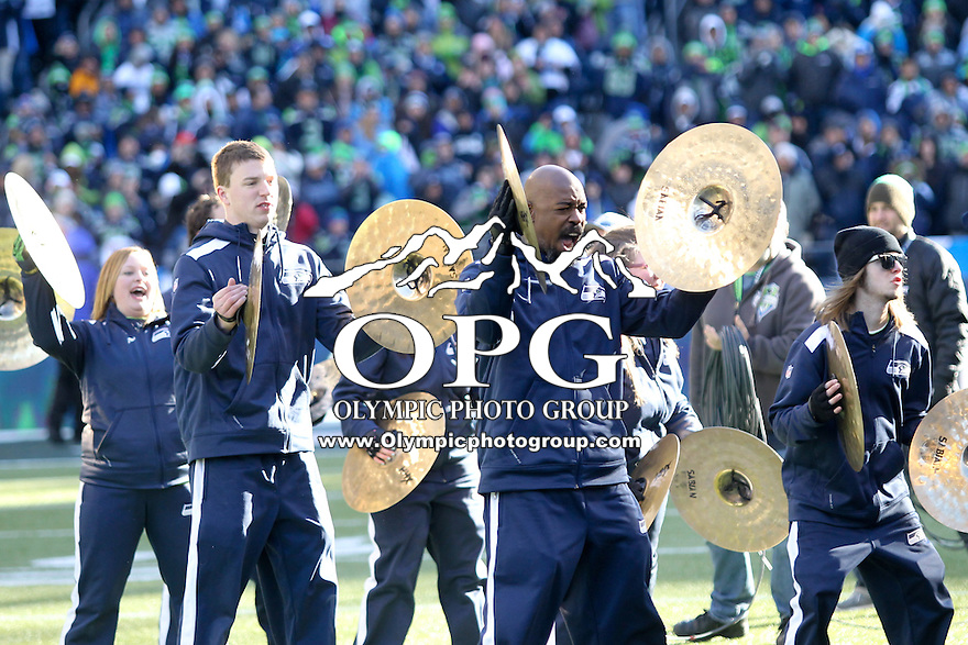 2014-02-05: The Seattle Blue Thunder kicked off the celebration on the field.  Seattle Seahawks players and 12th man fans celebrated bringing the Lombardi trophy home to Seattle during the Super Bowl Parade at Century Link Field in Seattle, WA.
