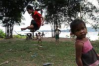 Playing along the Mekong, Khones falls, Don Khon island, Laos-2010
