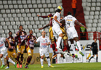 MANIZALES -COLOMBIA, 10-08-2013. Jugadoires saltan por el balón durtante encuentro entre Once Caldas y Deportes Tolima  válido por la fecha 3 de la Liga Postobón II 2013 jugado en el estadio Palogrande de la ciudad de Manizales./  Players jump for the ball during match between Once Caldas and Deportes Tolima during match valid for the third date of the Postobon  League II 2013 at Palogrande stadium in Manizales city. Photo: VizzorImage/Yonboni/STR