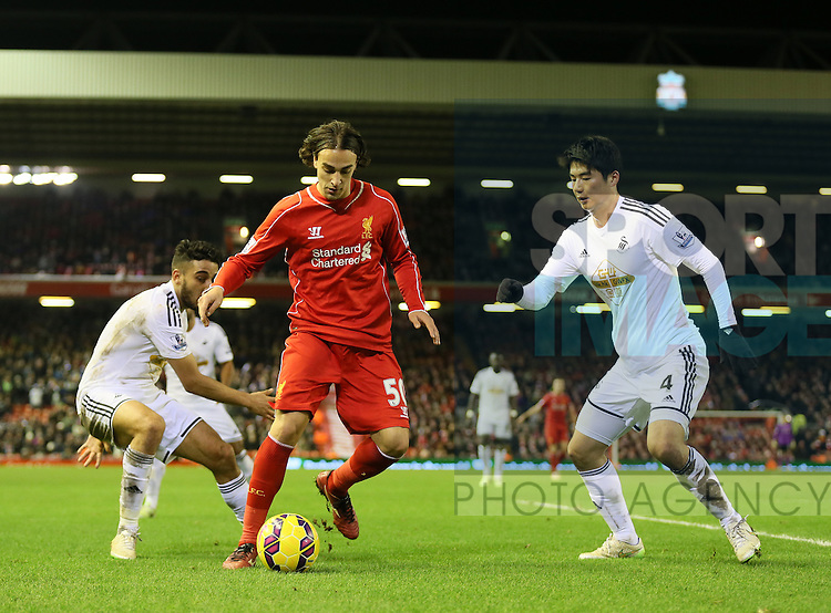 Lazar Markovic of Liverpool between Neil Taylor of Swansea City and Ki Sung Yueng of Swansea City  - Barclays Premier League - Liverpool vs Swansea City - Anfield Stadium - Liverpool - England - 29th December 2014  - Picture Simon Bellis/Sportimage