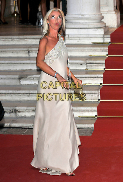 "TAMARA BECKWITH.""Valentino: The Last Emperor"" screening at the Gran Teatro de Fenice during the .65th Venice Film Festival, Venice, .Italy 28th August 2008. .full length one shoulder beige grey gray dress sparkly long maxi funny face mouth looking up clutch bag .CAP/PL.© Phil Loftus/Capital Pictures"
