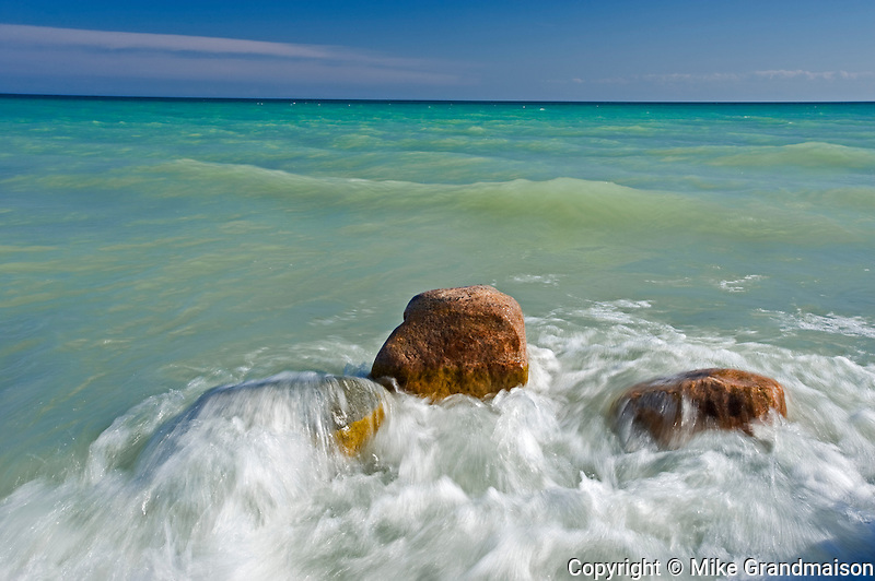 waves lapping over rocks on shore of Lake Ontario<br /> Presqu'ile Provincial Park<br /> Ontario<br /> Canada