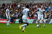 Saturday 17 August 2013<br /> <br /> Pictured: Ashley Williams (Captain)  of Swansea and Jonjo Shelvey of Swansea and Jonjo Shelvey of Swansea<br /> <br /> Re: Barclays Premier League Swansea City v Manchester United at the Liberty Stadium, Swansea, Wales