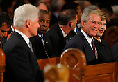 Boston, MA - August 29, 2009 -- Former President Bill Clinton (L) looks over at former President George W. Bush and his wife Barbara (R). during funeral services for U.S. Senator Edward Kennedy at the Basilica of Our Lady of  Perpetual Help in Boston, Massachusetts August 29, 2009.  Senator Kennedy died late Tuesday after a battle with cancer.   .Credit: Brian Snyder- Pool via CNP