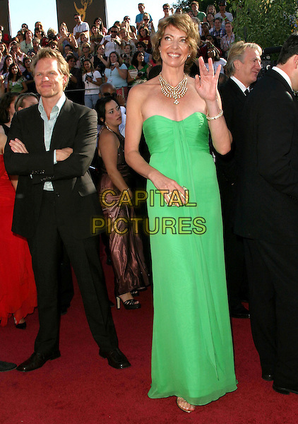 ALLISON JANNEY.6th Annual Prime Time Emmy Awards held at the Shrine Auditorium. .September 19th, 2004.full length, green dress, strapless, waving, gesture.www.capitalpictures.com.sales@capitalpictures.com.©Don Shaffer/AdMedia/Capital Pictures.
