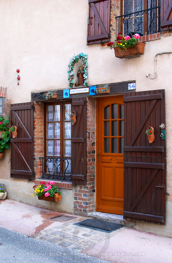 A decorated house with champagne symbols and flowers, the village of Hautvillers in Vallee de la Marne, Champagne, Marne, Ardennes, France