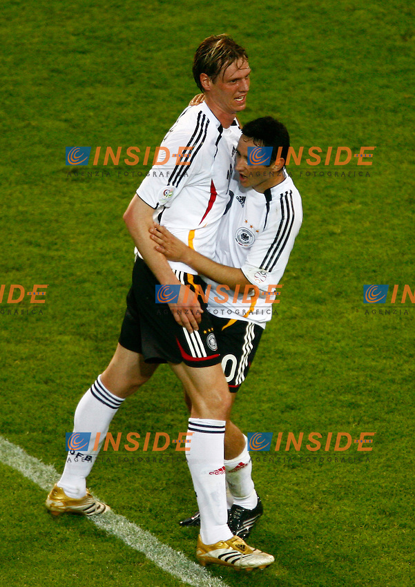 Dortmund 14/6/2006 World Cup 2006.Germany Poland - Germania Polonia 1-0.Photo Andrea Staccioli Insidefoto.Tim Borowski and Oliver Neuville celebrate at the end of the match
