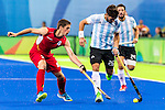 Agustin Mazzilli #26 of Argentina protects the ball from \BEL2\ Argentina vs Belgium  in the men's gold medal game at the Rio 2016 Olympics at the Olympic Hockey Centre in Rio de Janeiro, Brazil.