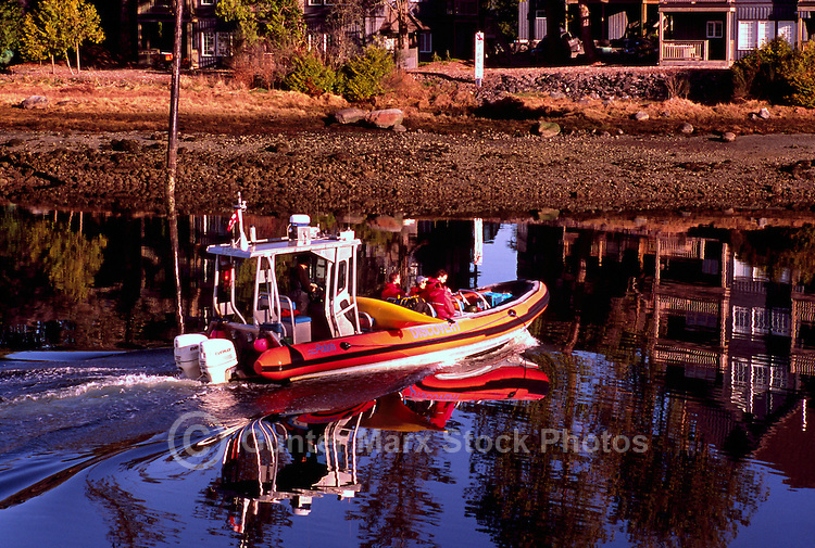 Tourists sightseeing onboard a Zodiac Boat leaving Ucluelet Harbour, Ucluelet, Vancouver Island, British Columbia, Canada