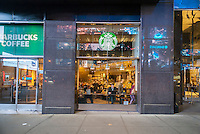 A Starbucks cafe near Times Square in New York seen on Tuesday, April 28, 2015. (© Richard B. Levine)