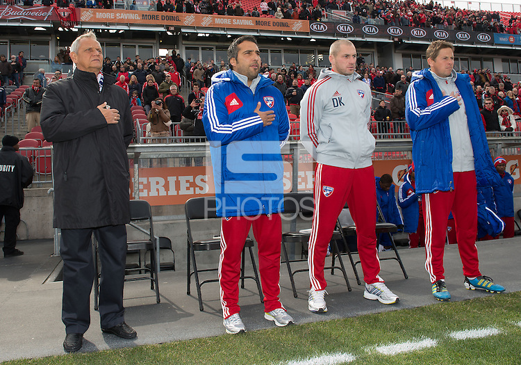 06 April 2013: FC Dallas head coach Schellas Hyndman and the rest of his coaching staff during the national anthems in an MLS game between FC Dallas and Toronto FC at BMO Field in Toronto, Ontario Canada..The game ended in a 2-2 draw..