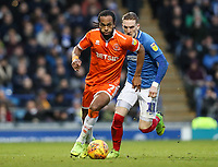 Blackpool's Nathan Delfouneso breaks away from Portsmouth's Ronan Curtis<br /> <br /> Photographer Andrew Kearns/CameraSport<br /> <br /> The EFL Sky Bet League One - Portsmouth v Blackpool - Saturday 12th January 2019 - Fratton Park - Portsmouth<br /> <br /> World Copyright &copy; 2019 CameraSport. All rights reserved. 43 Linden Ave. Countesthorpe. Leicester. England. LE8 5PG - Tel: +44 (0) 116 277 4147 - admin@camerasport.com - www.camerasport.com