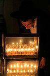 Lighting the Hanukkah candles in Bnei Brak, Israel