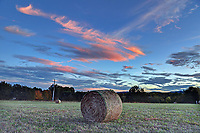 Hay bales in a field off a country road close to Charlottesville, Va.  Photo/Andrew Shurtleff Photography, LLC
