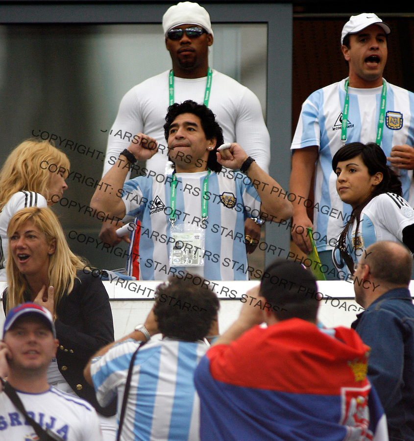 Jun 16, 2006; GELSENKICHEN, Germany; Argentina superstar MARADONA waves to supportes during the first half of the opening round FIFA World Cup soccer match between Argentina & Serbia and Montenegro, at the World Cupa Arena at GELSENKICHEN, Germany. Mandatory Credit: Srdjan Stevanovic-US PRESSWIRE Copyright © 2006 Srdjan Stevanovic.