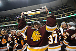 09 APR 2011:  Minnesota Duluth Bulldogs goalie Kenny Reiter (35) lifts the championship trophy during the Division I Men's Ice Hockey Championship held at the Xcel Energy Center in St. Paul, MN. Minnesota-Duluth beat Michigan in overtime, 3-2 to claim the national title. Vince Muzik/ NCAA Photos