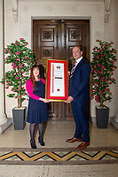 Pictured: Judith Porch (calligrapher for the scroll) with Alun Wyn Jones as he is awarded the freedom of Swansea at Swansea's Guildhall, Swansea, Wales, UK. Wednesday 12 June 2019<br /> Re: Ospreys, Wales and Lions star Alun Wyn Jones has been awarded the freedom of Swansea for his achievements in rugby during a ceremony at the Guildhall in Swansea, Wales, UK.<br /> He has 134 international caps to his name; three Grand Slam titles with Wales, and has toured with the British and Irish Lions on three separate occasions.