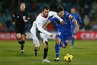 19.01.2013 SPAIN -  La Liga 12/13 Matchday 20th  match played between Getafe C.F. vs Sevilla Futbol Club (1-1) at Alfonso Perez stadium. The picture show Jaime Gavilan Martinez (Midfielder of Getafe) and Alex Sandro Mendoca (Spanish midfielder of Sevilla C.F.)