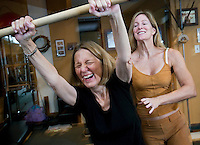 Pilates instructor Sherry Brady works with Dr. Gillian Hamilton, 65, on her form at Brady's Studio Joe PIlates in Scottsdale. Hamilton is vice president education/innovation, Hospice of the Valley, and works out regularly at the studio.
