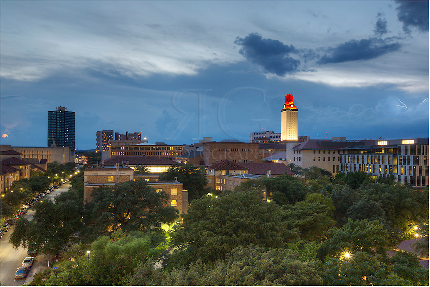 The University of Texas Tower is lit up on a stormy night. This Texas image was captured from the ramp at DKR Texas Memorial Stadium near downtown Austin.