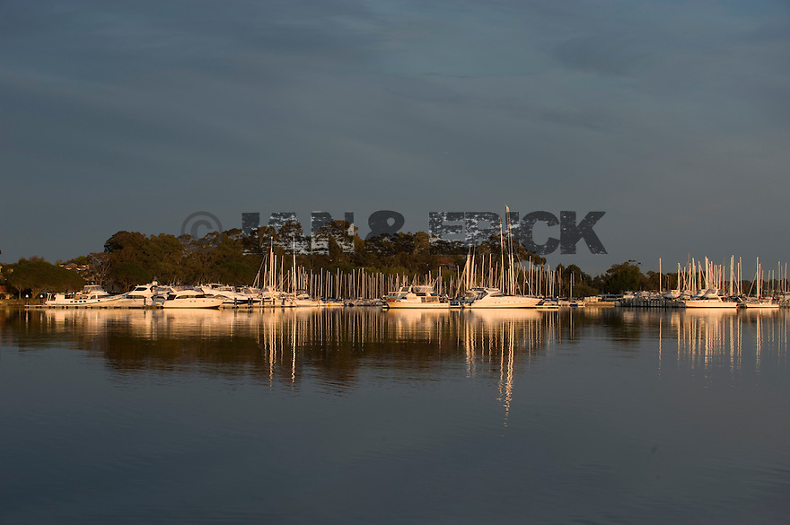 reflection of boats on the Swan river at the South Perth Yachting Club, Western Australia