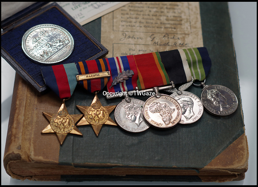 BNPS.co.uk (01202 558833)<br /> Pic: TWGaze/BNPS<br /> <br /> Midshipman John Pike's WW2 medals and the logbook.<br /> <br /> A forgotten account of a tragic incident just as WW2 was finally ending has emerged in the diaries of a British midshipman.<br /> <br /> The officer's log exposes a potential cover up over the deaths of five seamen who were apparently killed in the final salvos of World War Two.<br /> <br /> Midshipman John Pike wrote of how at the very moment the order to cease fire against Japan on August 15, 1945 came through his ship came under attack by a lone kamikaze aircraft.<br /> <br /> The dive bomber fired its machine guns at the quarterdeck of HMS Gambia, prompting the crew to scatter and the ship to fire its guns in retaliation.<br /> <br /> Moments later two American Corsair fighter planes arrived and shot the enemy plane out of the sky. <br /> <br /> With the danger cleared the crew of the navy cruiser gathered themselves and realised that five men had been killed by the machine gun fire.