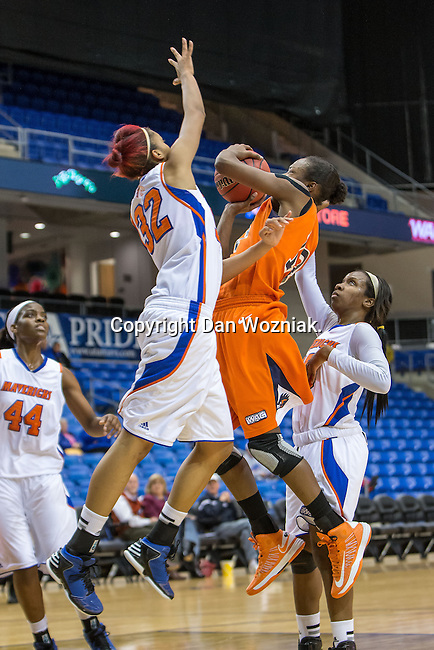 Texas Arlington Mavericks forward Aron Garcia (32) and UTSA Roadrunners guard/forward Niaga Mitchell-Cole (12) in action during the game between the UTSA Roadrunners and the Texas Arlington Mavericks at the College Park Center arena in Arlington, Texas. UTSA defeats UTA 59 to 57....