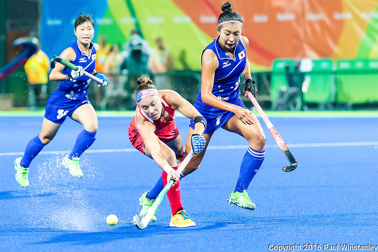 Michelle Kasold #18 of United States passes the ball while Aki Mitsuhashi #7 of Japan tries to keep up during USA vs Japan in a Pool B game at the Rio 2016 Olympics at the Olympic Hockey Centre in Rio de Janeiro, Brazil.
