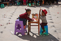 East Village, Diqing Tibetan Autonomous Prefecture, Yunnan Province, China - Tibetan children play after traditional Xianzi Dance performance, February 2017.