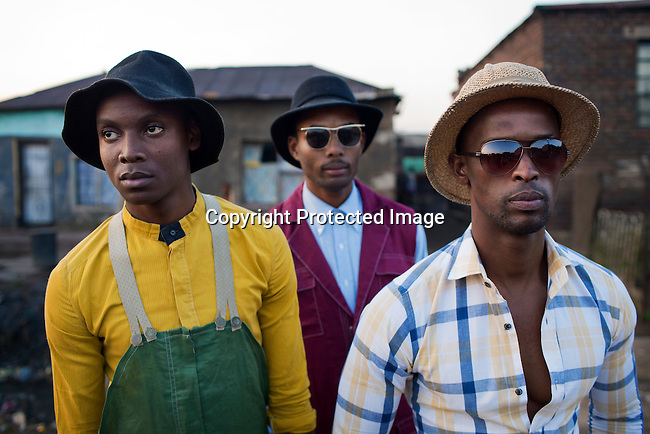 SOWETO, SOUTH AFRICA MAY 21: Models wait to be photographed for the group Smarteez during a photo shoot on May 21, 2013 in Kliptown section of Soweto, South Africa. They did a photo shoot together with a new collection. Soweto today is a mix of old housing and newly constructed townhouses. A new hungry black middle-class is growing steadily. Many residents work in Johannesburg but the last years many shopping malls have been built, and people are starting to spend their money in Soweto. (Photo by: Per-Anders Pettersson)