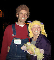 BNPS.co.uk (01202 558833)<br /> Pic: AmandaLillie/BNPS<br /> <br /> ***Please use full byline***<br /> <br /> All dolled up! Amanda Lillie and her husband Jon wear the Cabbage Patch hats at Halloween. <br /> <br /> A fan of the Cabbage Patch Kids dolls has created a bizarre range of woollen wigs so that people can dress up as the iconic child's toy.<br /> <br /> The original dolls were created in 1978 and had fabric bodies, vinyl heads, and hair made from wool to look like a number of popular styles of the day.<br /> <br /> Although the toys are now made with cornsilk hair, an enthusiast has crocheted wigs to look like the traditional yarn ponytails, plaits, bunches, and ringlets.<br /> <br /> The accessories can be made in a variety of sizes to fit babies, children, and adults who wish to dress up like the popular dolls.<br /> <br /> Amanda Lillie, 32, had the idea for the wacky headwear when she stumbled upon a version online and wanted to make her own improved version.<br /> <br /> She unearthered her own doll collection and studied their hairstyles for inspiration before creating her own from acrylic wool.<br /> <br /> Amanda has now made a variety of different wigs in yellow, brown, black and red and each one takes around two hours to complete.<br /> <br /> They are sold on www.etsy.com/uk/shop/TheLilliePad for prices between &pound;13 and &pound;26.