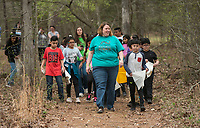 NWA Democrat-Gazette/BEN GOFF @NWABENGOFF<br /> Becky Olthof, Ozark Natural Science Center interim executive director, leads a group of 4th graders from Brighton Park school in Chicago on a walk Friday, April 13, 2018, at Ozark Natural Science Center near Huntsville. The 4th grade students from Brighton Park, a public charter school, are visiting for a five day immersive environmental education program.