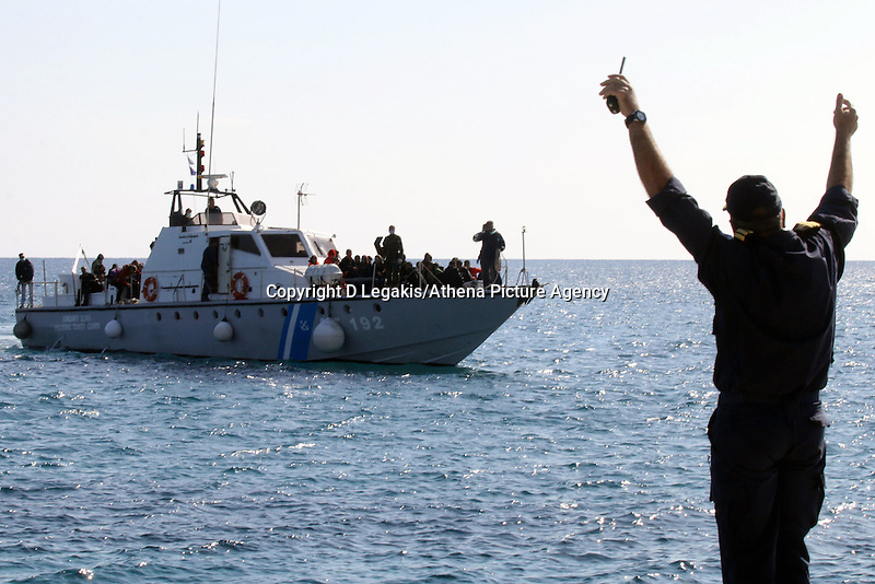 Pictured: The Coastguard vessel which carries dozens of illegal immigrants approaches Ierapetra Thursday 27 November 2014<br />
