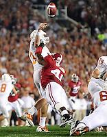 Jan 7, 2010; Pasadena, CA, USA; Texas Longhorns quarterback Garrett Gilbert (3) is hit as he throws by Alabama Crimson Tide linebacker Courtney Upshaw (41) during the second quarter of the 2010 BCS national championship game at the Rose Bowl.  Mandatory Credit: Mark J. Rebilas-