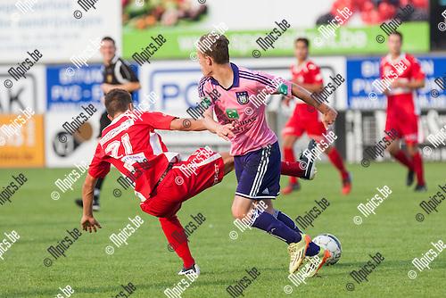 2014-07-26 / Voetbal / Seizoen 2014-2015 / Oefenwedstrijd / Hoogstraten VV-RSC Anderlecht beloften / Zeb Jacobs (Hoogstraten) in duel met Gilles Denayer (Anderlecht)<br /> <br /> Foto: Mpics.be