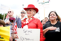 Corinna Reese (cq, in red) and Lyla Malzahn (cq, right) share in a memorial for US war veterans at a rally for the Tea Party Express, a traveling national bus tour of people against higher government spending, higher taxes, and President Obama's push to reform health care, at the Cape Buffalo Grille in Dallas, Texas, Friday, September 4, 2009. The Tea Party Express is heading to Washington, DC where it will hold a final rally and march...MATT NAGER/ SPECIAL CONTRIBUTOR