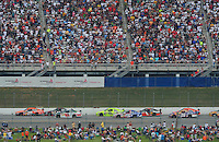 Apr 27, 2008; Talladega, AL, USA; NASCAR Sprint Cup Series driver Tony Stewart (20) leads the field during the Aarons 499 at Talladega Superspeedway. Mandatory Credit: Mark J. Rebilas-