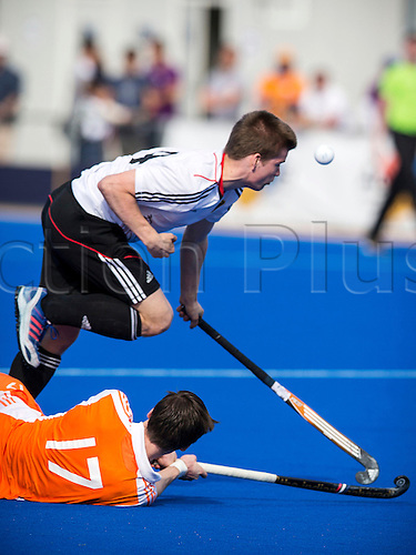 01.04.2013 Valencia, Spain. Max Justus Godau of Germany (UP) takes on Bram Van Groesen of Holland during the Hockey 4 Nations U18 Men Easter Tournament Valencia 2013 Final game between Germany and Netherlands from the Campo de Hockey Valencia