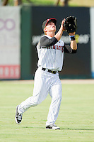 Left fielder Collin Kuhn #13 of the Kannapolis Intimidators settles under a fly ball against the Delmarva Shorebirds at Fieldcrest Cannon Stadium on August 7, 2011 in Kannapolis, North Carolina.  The Intimidators defeated the Shorebirds 8-3.   (Brian Westerholt / Four Seam Images)
