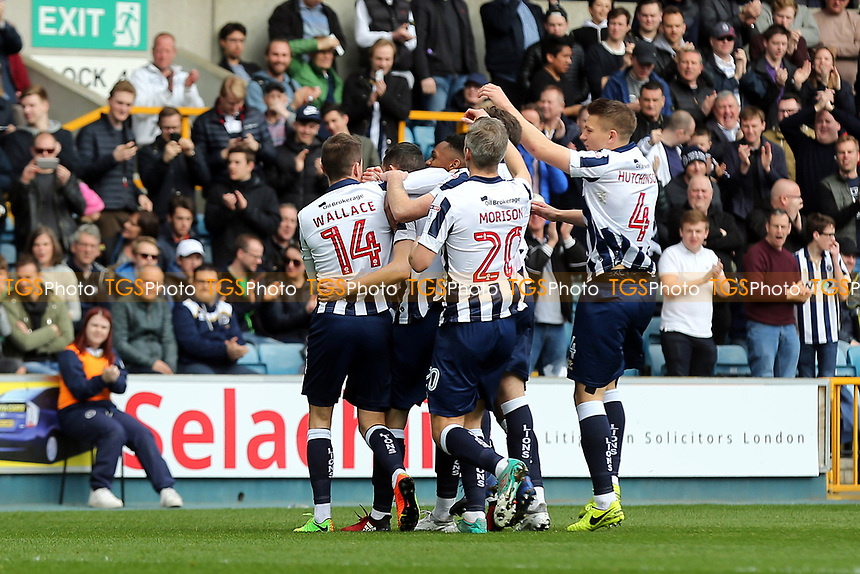 Millwall players celebrate their opening goal scored by Shaun Williams during Millwall vs Scunthorpe United, Sky Bet EFL League 1 Football at The Den on 1st April 2017
