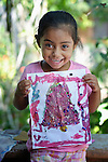 Evelyn Garcia Aguilar shows artwork she created during a session of the early intervention program of Piña Palmera, a center for community based rehabilitation for people living with disabilities in Zipolite, a town in Oaxaca, Mexico. The 4-year old girl is deaf.