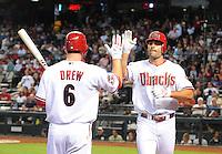 Apr. 30, 2008; Phoenix, AZ, USA; Arizona Diamondbacks first baseman Conor Jackson (right) is congratulated by Stephen Drew after hitting a home run against the Houston Astros at Chase Field. Mandatory Credit: Mark J. Rebilas-
