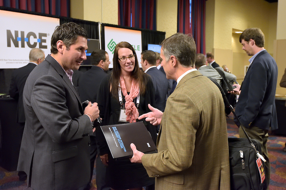 Attendees networking at a trade show.