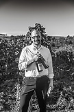 USA, Oregon, Willamette Valley, a wine sommelier pours wine at an event called Bounty of the County at the Sokol Blosser Winery, Dayton