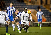 Adebayo Akinfenwa of Wycombe Wanderers turns Cameron James of Colchester United during the Sky Bet League 2 match between Colchester United and Wycombe Wanderers at the Weston Homes Community Stadium, Colchester, England on 21 February 2017. Photo by Andy Rowland / PRiME Media Images.