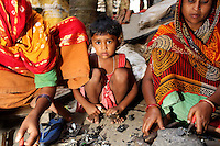 Women and children sift through used electronics in a village near Kolkata.<br /> <br /> To license this image, please contact the National Geographic Creative Collection:<br /> <br /> Image ID: 1925794 <br />  <br /> Email: natgeocreative@ngs.org<br /> <br /> Telephone: 202 857 7537 / Toll Free 800 434 2244<br /> <br /> National Geographic Creative<br /> 1145 17th St NW, Washington DC 20036