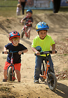 NWA Democrat-Gazette/BEN GOFF @NWABENGOFF<br /> Brown Faubus (left), of Bentonville and Hewitt Sluyter, both 3, of Elm Springs, take laps round the pump track on strider bikes on Saturday Oct. 3, 2015 during the Slaughter Pen Jam mountain bike festival at the Slaughter Pen trails in Bentonville. Saturday featured a mini downhill race, races and skills clinics for children and an archery-mountain bike biathlon.