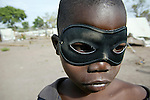 Sudanese boy wearing an eye mask in a refugee camp in Chad