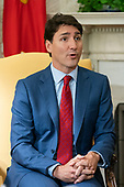 Canadian Prime Minister Justin Trudeau speaks alongside US President Donald J. Trump (not pictured) in the Oval Office of the White House in Washington, DC, USA, 20 June 2019. The president spoke to the media about Iran shooting down an American drone, saying it might not have been intentional.<br /> Credit: Jim LoScalzo / Pool via CNP